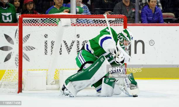 James Reimer of the Carolina Hurricanes makes a glove save in the crease during an NHL game against the Los Angeles Kings on January 11 2020 at PNC...