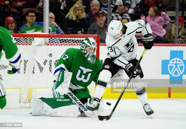 James Reimer of the Carolina Hurricanes makes a pad save as Tyler Toffoli of the Los Angeles Kings creates traffic during an NHL game on January 11...