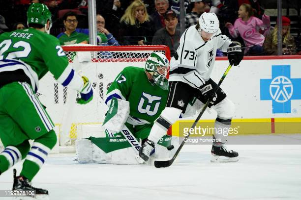 James Reimer of the Carolina Hurricanes makes a pad save as Tyler Toffoli of the Los Angeles Kings create traffic during an NHL game on January 11...