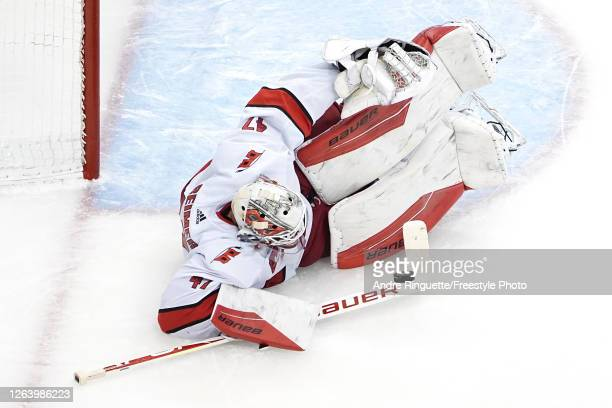 James Reimer of the Carolina Hurricanes makes a save against the New York Rangers during the third period in Game Three of the Eastern Conference...