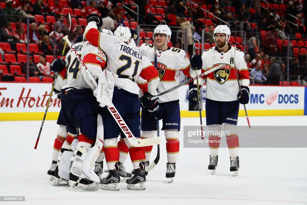 James Reimer #34 of the Florida Panthers celebrates a 2-1 overtime win over the Detroit Red Wings with teammates at Little Caesars Arena on December 11, 2017 in Detroit, Michigan.