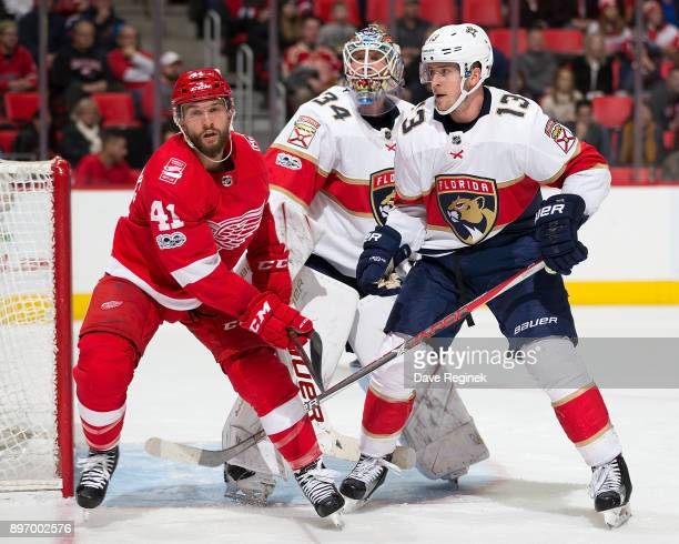James Reimer of the Florida Panthers follows the play as teammate Mark Pysyk defends against Luke Glendening of the Detroit Red Wings during an NHL...