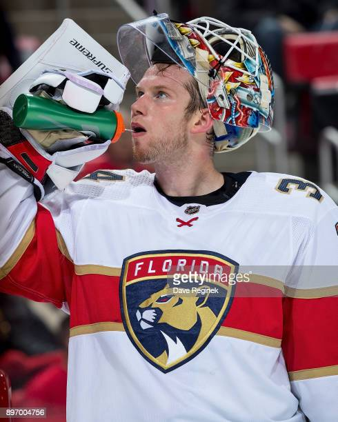 James Reimer of the Florida Panthers gets a drink of water on a play stoppage against the Detroit Red Wings during an NHL game at Little Caesars...