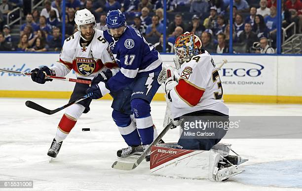 James Reimer of the Florida Panthers makes a save in front of Alex Killorn of the Tampa Bay Lightning as Aaron Ekblad defends during the second...
