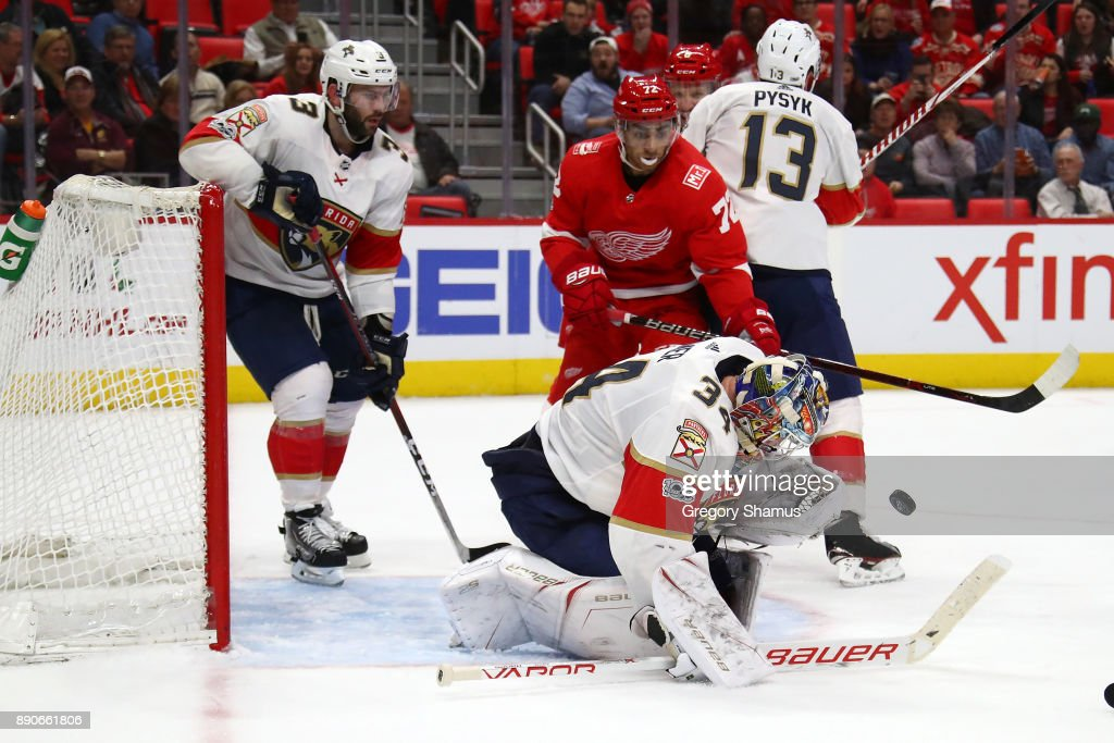 James Reimer #34 of the Florida Panthers makes a third period save in front of Andreas Athanasiou #72 of the Detroit Red Wings at Little Caesars Arena on December 11, 2017 in Detroit, Florida won the game 2-1 in overtime. Michigan.