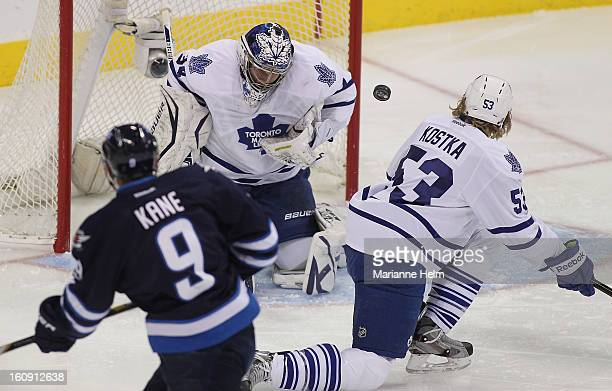 James Reimer of the Toronto Maple Leafs blocks a shot on goal in a game against the Winnipeg Jets during first-period action on February 7, 2013 at...