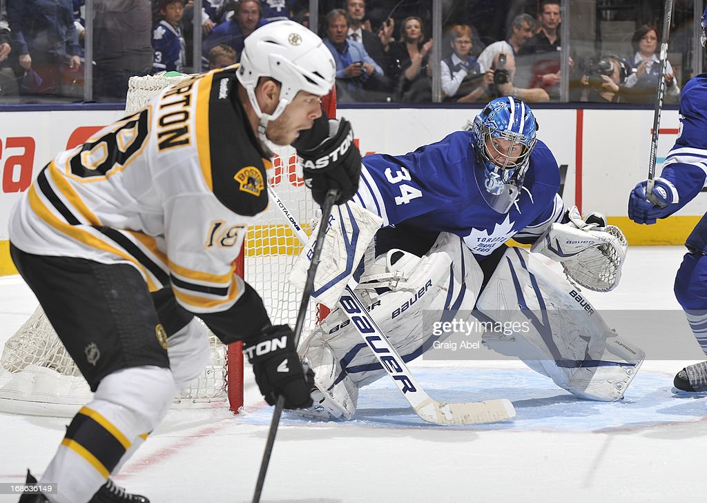 James Reimer #34 of the Toronto Maple Leafs defends the goal as Nathan Horton #18 of the Boston Bruins looks to pass in Game Six of the Eastern Conference Quarterfinals during the 2013 NHL Stanley Cup Playoffs May 12, 2013 at the Air Canada Centre in Toronto, Ontario, Canada.