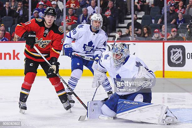 James Reimer of the Toronto Maple Leafs defends the net against the Calgary Flames during an NHL game at Scotiabank Saddledome on February 9 2016 in...