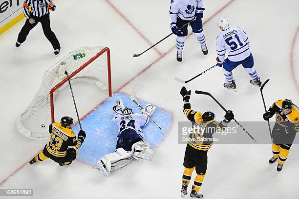 James Reimer of the Toronto Maple Leafs lays on the ice after letting in a goal in overtime against the Boston Bruins in Game Seven of the Eastern...