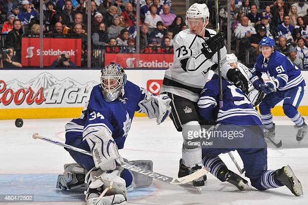 James Reimer of the Toronto Maple Leafs makes a blocker save as teammate Korbinian Holzer battles with Tyler Toffoli of the Los Angeles Kings during...