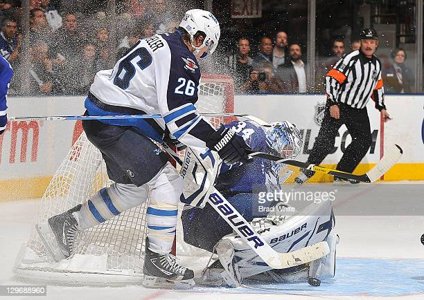James Reimer of the Toronto Maple Leafs makes a pad save on Blake Wheeler of the Winnipeg Jets during NHL game action October 19 2011 at Air Canada...