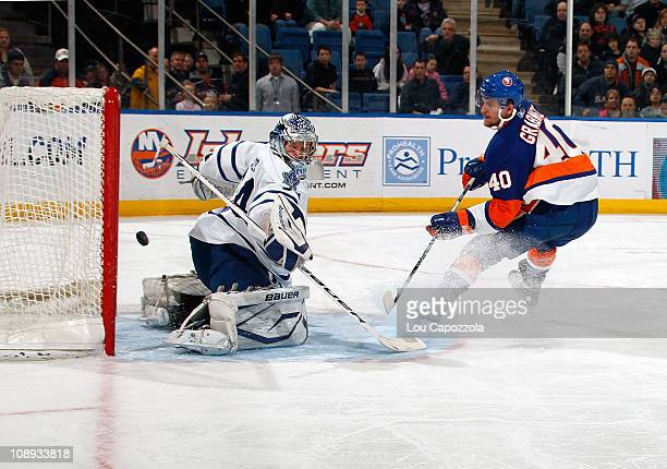 James Reimer of the Toronto Maple Leafs makes a save against Michael Grabner of the New York Islanders during the second period on February 8 2011 at...