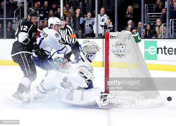James Reimer of the Toronto Maple Leafs makes a save on Marian Gaborik of the Los Angeles Kings as Jake Gardiner looks for a rebound during the...