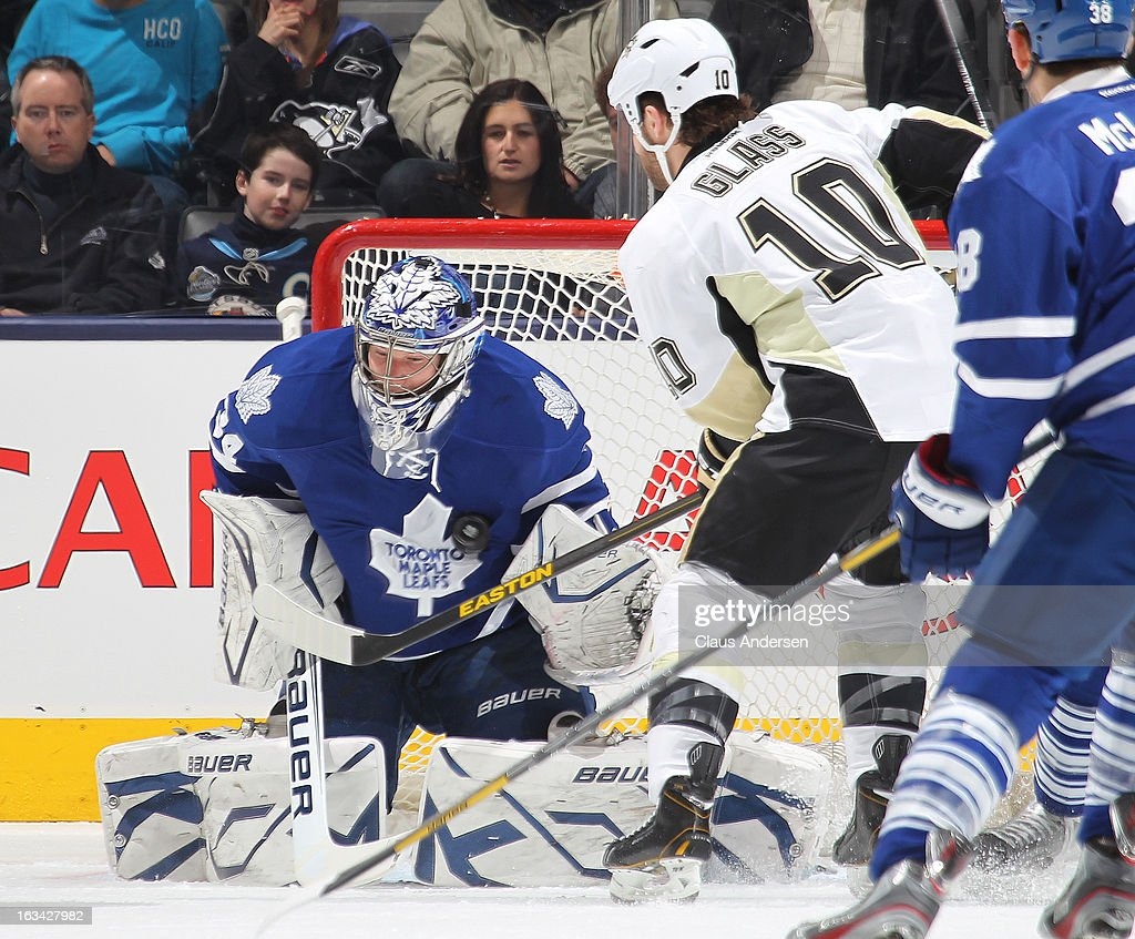 James Reimer #34 of the Toronto Maple Leafs makes a save on Tanner Glass #10 of the Pittsburgh Penguins in a game on March 9, 2013 at the Air Canada Centre in Toronto, Ontario, Canada.