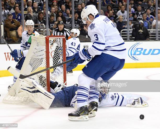 James Reimer of the Toronto Maple Leafs makes scrambles for a rebound with Dion Phaneuf after a save on a shot from the Los Angeles Kings during the...