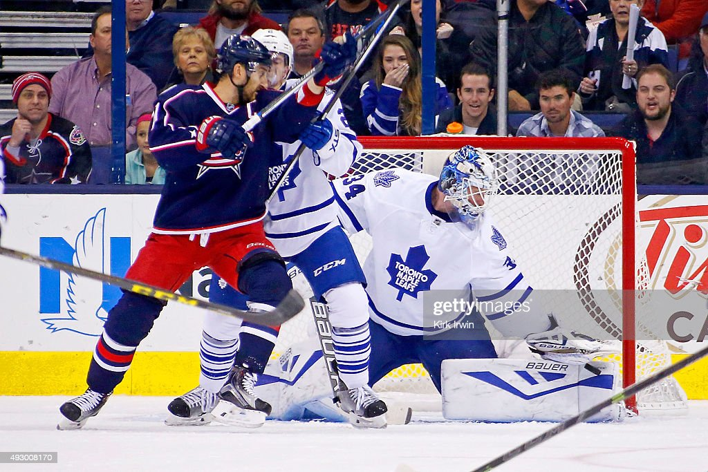 James Reimer #34 of the Toronto Maple Leafs stops a shot as Nick Foligno #71 of the Columbus Blue Jackets attempts to apply a screen during the third period on October 16, 2015 at Nationwide Arena in Columbus, Ohio. Toronto defeated Columbus 6-3.