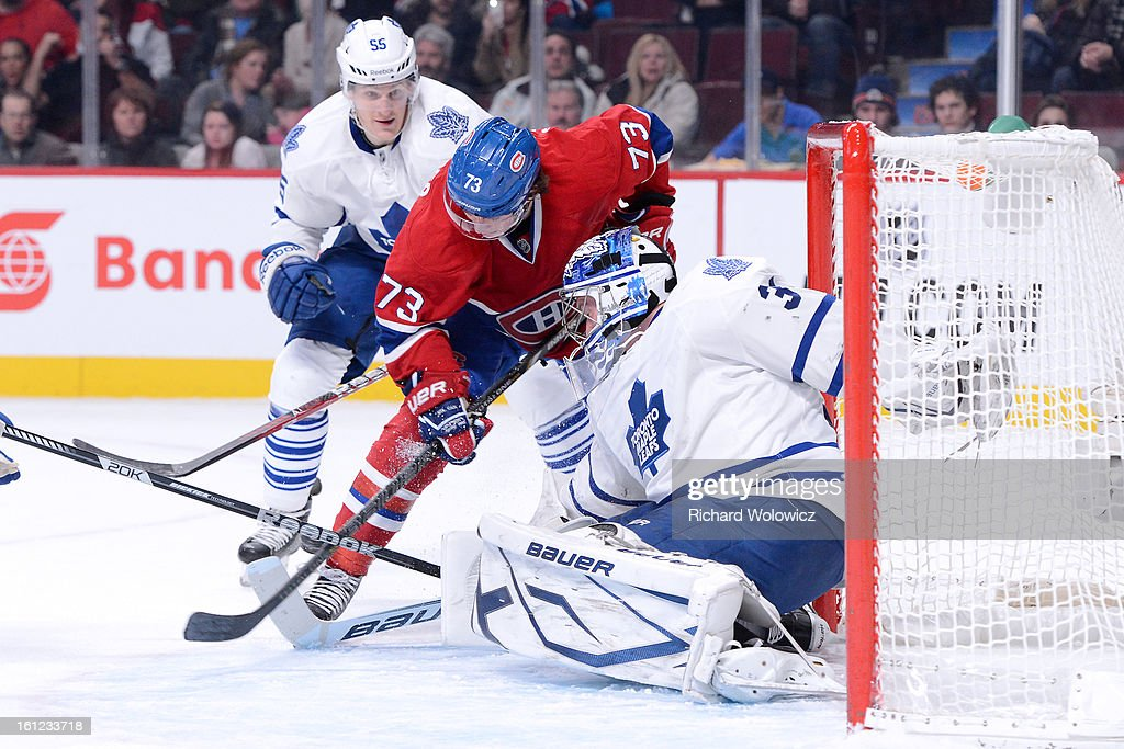 James Reimer #34 of the Toronto Maple Leafs stops the puck on an attempt by Brendan Gallagher #73 of the Montreal Canadiens during the NHL game at the Bell Centre on February 9, 2013 in Montreal, Quebec, Canada.