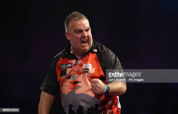 James Richardson celebrates taking the first set against Alan Norris during day eleven of the William Hill World Darts Championship at Alexandra...