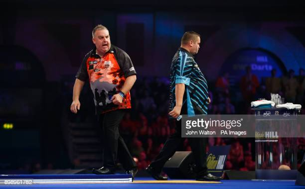 James Richardson celebrates winning a set against Alan Norris during day eleven of the William Hill World Darts Championship at Alexandra Palace...