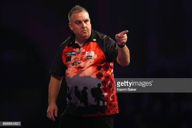 James Richardson of England celebrates winning a set during his second round match against Alan Norris of Scotland on day eleven of the 2018 William...