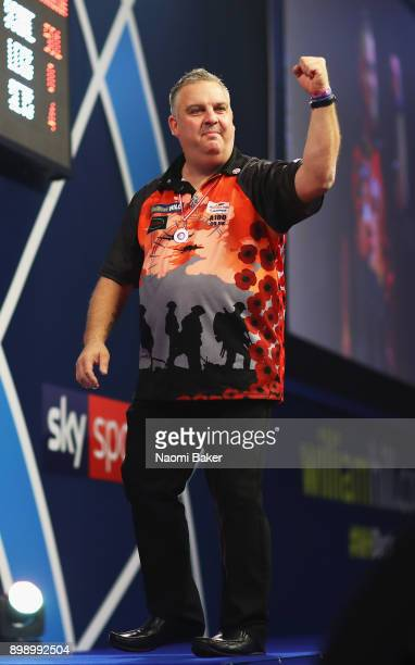 James Richardson of England celebrates winning his second round match against Alan Norris of Scotland on day eleven of the 2018 William Hill PDC...