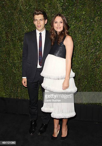 James Righton and actress Keira Knightley attend the Chanel and Charles Finch PreOscar Dinner at Madeo Restaurant on February 21 2015 in Los Angeles...