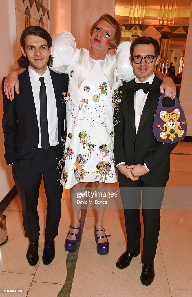 James Righton, Grayson Perry and Erdem Moralioglu attend the Harper's Bazaar Women of the Year Awards 2016 at Claridge's Hotel on October 31, 2016 in London, England.