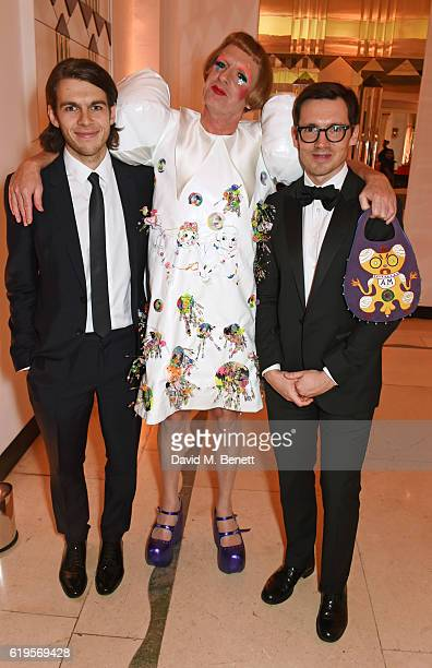 James Righton Grayson Perry and Erdem Moralioglu attend the Harper's Bazaar Women of the Year Awards 2016 at Claridge's Hotel on October 31 2016 in...