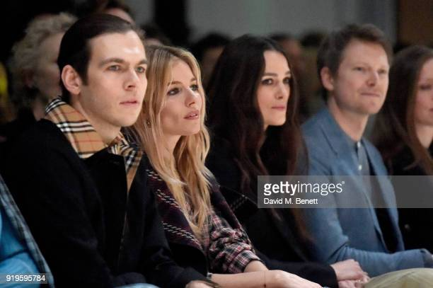 James Righton Sienna Miller Keira Knightley and Simon Woods wearing Burberry at the Burberry February 2018 show during London Fashion Week at Dimco...
