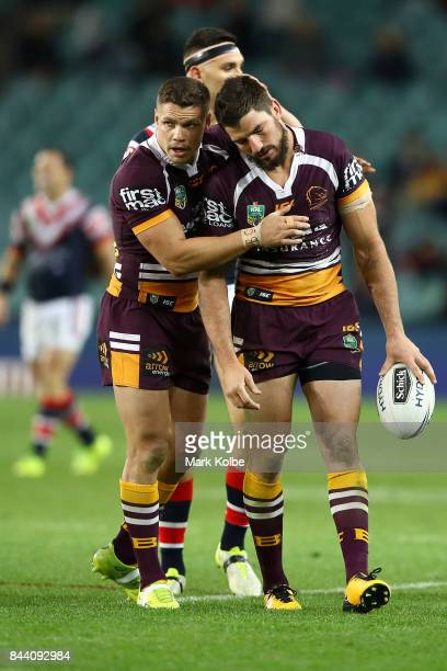 James Roberts and Matt Gillett of the Broncos looks dejected during the NRL Qualifying Final match between the Sydney Roosters and the Brisbane...