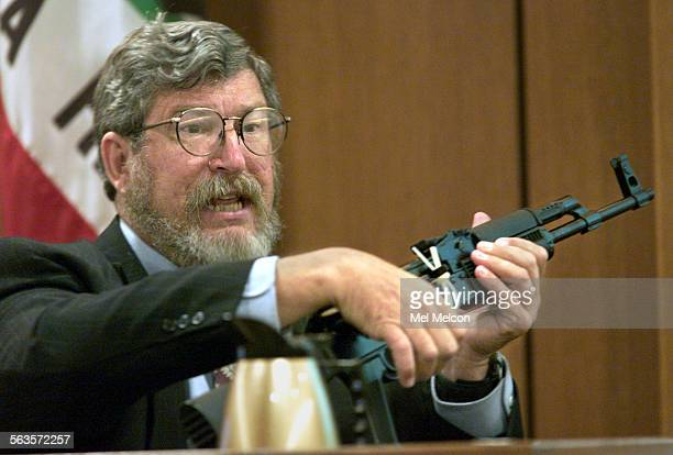 James Roberts firearms expert for the Ventura County Sheriff's Dept Crime Lab shows jury assualt rifle that authorities believe was used to kill...