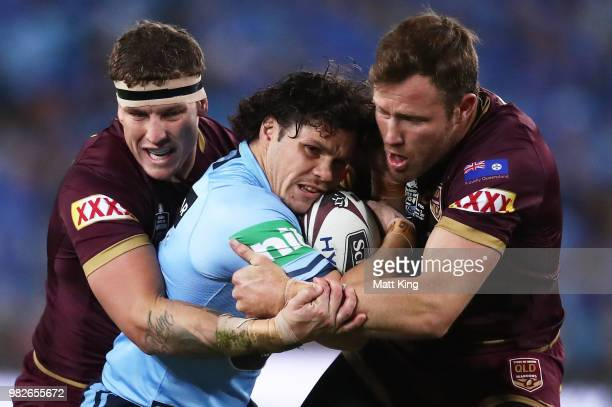 James Roberts of the Blues is tackled during game two of the State of Origin series between the New South Wales Blues and the Queensland Maroons at...