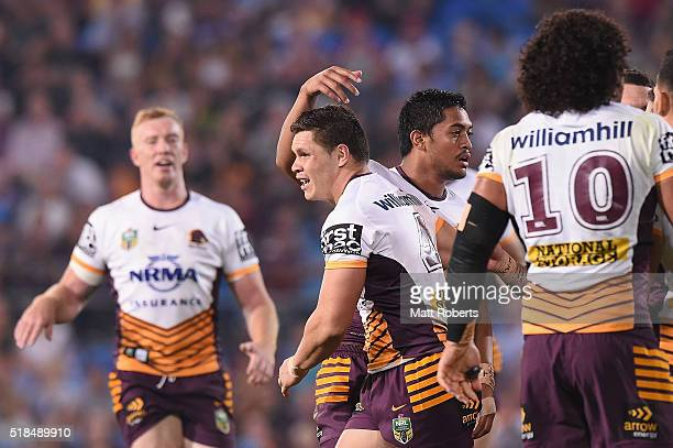 James Roberts of the Broncos celebrates scoring a try with team mates during the round five NRL match between the Gold Coast Titans and the Brisbane...