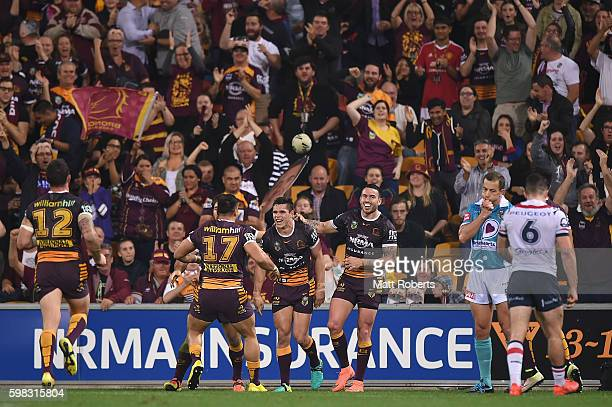 James Roberts of the Broncos celebrates scoring a try with team mates during the round 26 NRL match between the Brisbane Broncos and the Sydney...