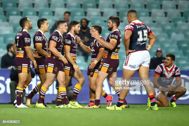 James Roberts of the Broncos celebrates with his team mates after scoring a try during the NRL Qualifying Final match between the Sydney Roosters and...