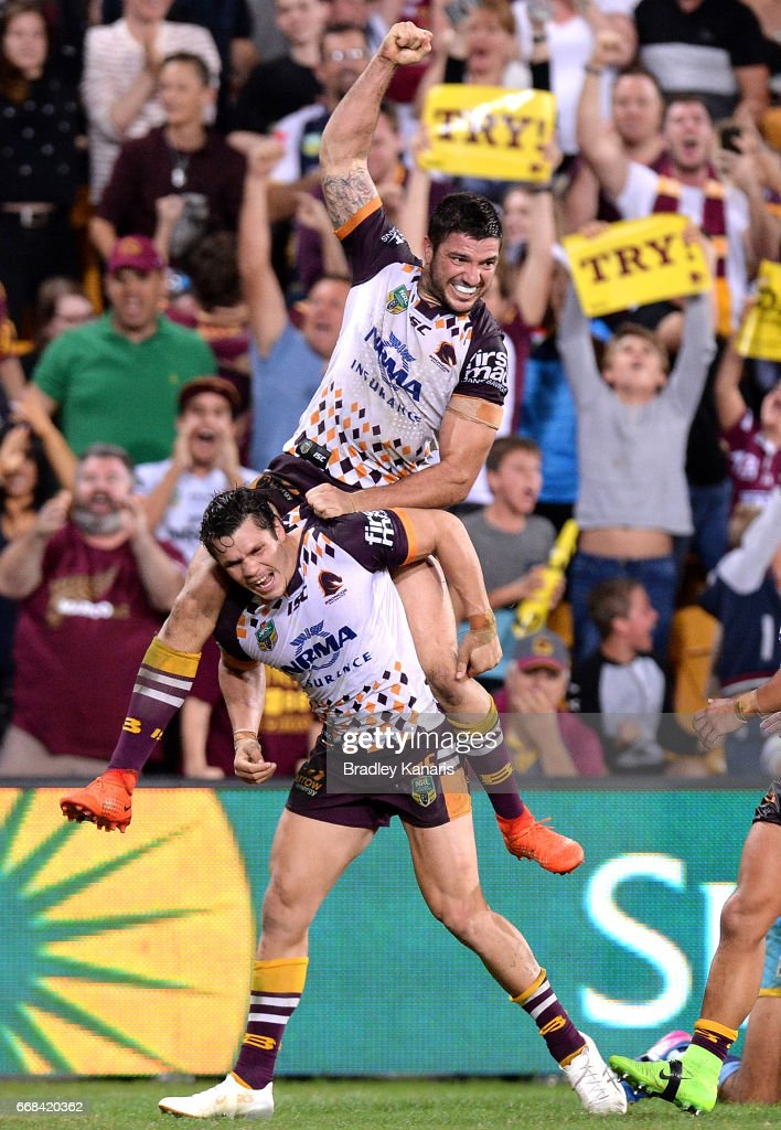 James Roberts of the Broncos celebrates with Matt Gillett after scoring the match winning try during the round seven NRL match between the Brisbane Broncos and the Gold Coast Titans at Suncorp Stadium on April 14, 2017 in Brisbane, Australia.