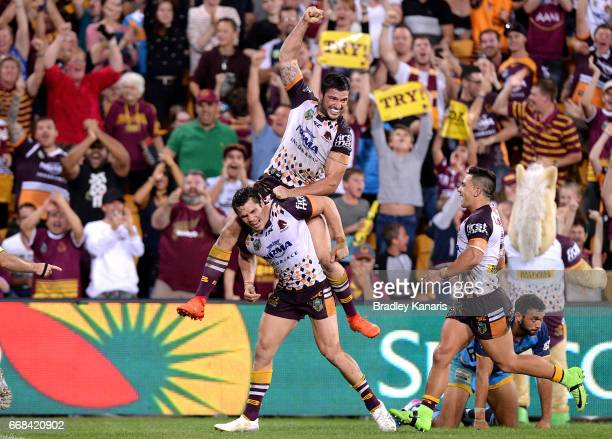 James Roberts of the Broncos celebrates with Matt Gillett after scoring the match winning try during the round seven NRL match between the Brisbane...