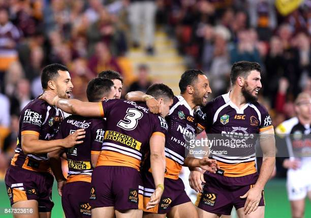 James Roberts of the Broncos is congratulated by team mates after scoring a try during the NRL Semi Final match between the Brisbane Broncos and the...