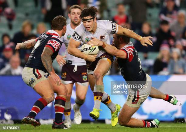 James Roberts of the Broncos is tackled during the round 13 NRL match between the Sydney Roosters and the Brisbane Broncos at Allianz Stadium on June...