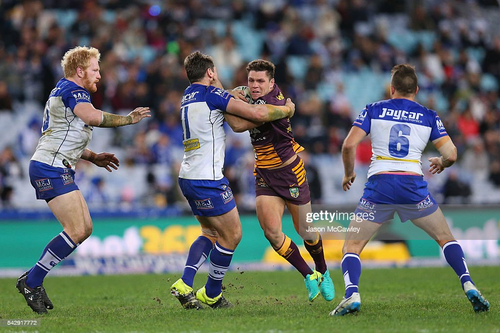 James Roberts of the Broncos is tackled during the round 16 NRL match between the Canterbury Bulldogs and Brisbane Broncos at ANZ Stadium on June 25, 2016 in Sydney, Australia.