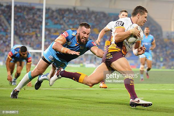 James Roberts of the Broncos scores a try during the round five NRL match between the Gold Coast Titans and the Brisbane Broncos at Cbus Super...
