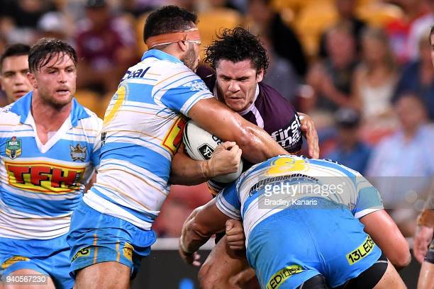 James Roberts of the Broncos takes on the defence during the round four NRL match between the Brisbane Broncos and the Gold Coast Titans at Suncorp...