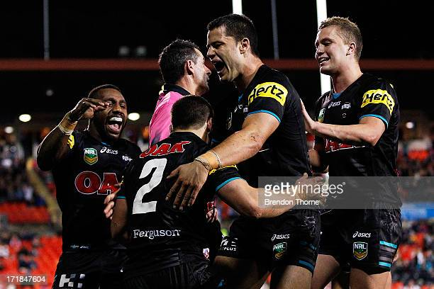James Roberts of the Panthers celebrates with team mates after scoring a try during the round 16 NRL match between the Penrith Panthers and the St...