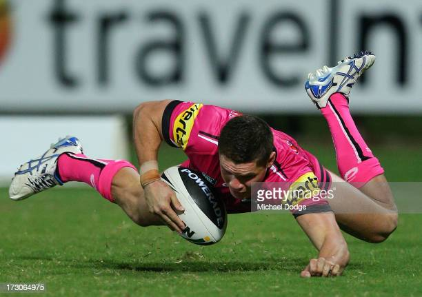 James Roberts of the Panthers scores a try during the round 17 NRL match between the Gold Coast Titans and the Penrith Panthers at TIO Stadium on...