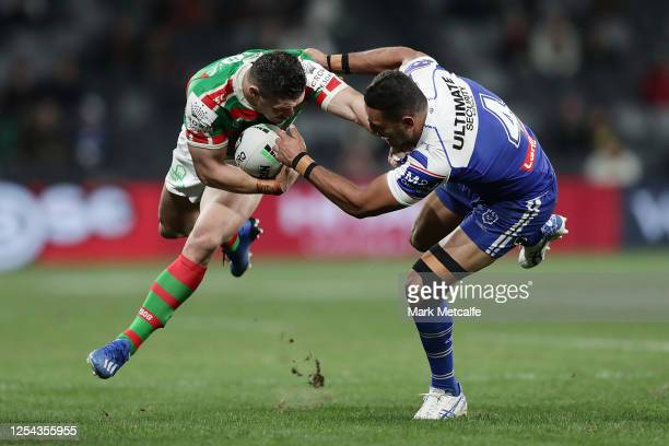 James Roberts of the Rabbitohs Is tackled by Marcela Montoya of the Bulldogs during the round eight NRL match between the Canterbury Bulldogs and the...