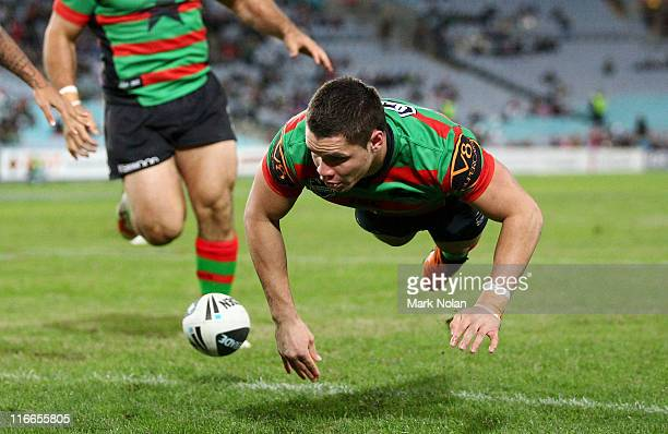 James Roberts of the Rabbitohs scores a try during the round 15 NRL match between the South Sydney Rabbitohs and the Gold Coast Titans at ANZ Stadium...