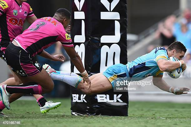 James Roberts of the Titans scores a try during the round seven NRL match between the Gold Coast Titans and the Penrith Panthers at Cbus Super...