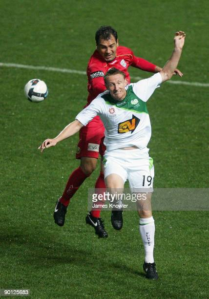 James Robinson of Fury challenges Mark Rudan of United during the round four ALeague match between Adelaide United and the North Queensland Fury at...