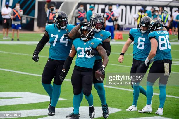 James Robinson of the Jacksonville Jaguars celebrates with teammates after rushing for a touchdown during the first half against the Houston Texans...