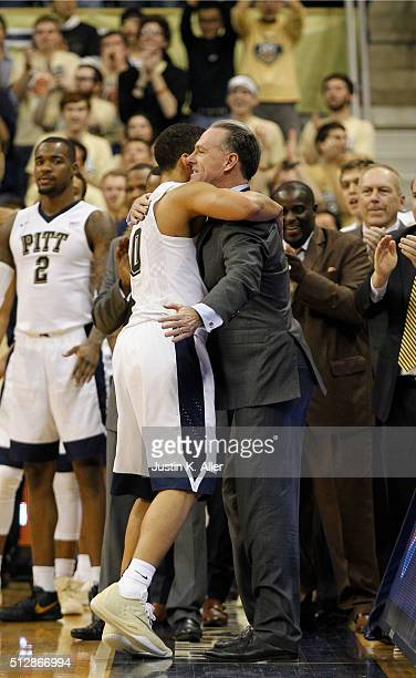 James Robinson of the Pittsburgh Panthers and Jamie Dixon celebrate during the game against the Duke Blue Devils at Petersen Events Center on...
